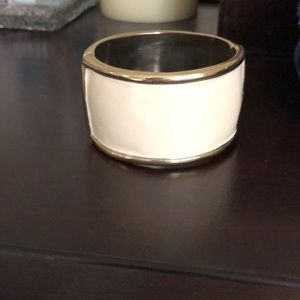Kate spade cream and gold thick bangle bracelet.